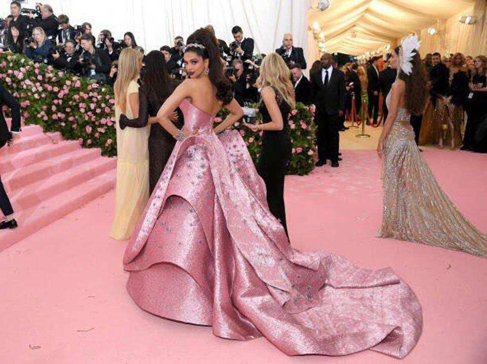 Deepika Padukone wearing a structural princess gown by Zac Posen at Met Gala (Below)Priyanka Chopra Jonas went for a a frothy gray Dior haute couture number as she walked on the red carpet with Nick Jonas last year.